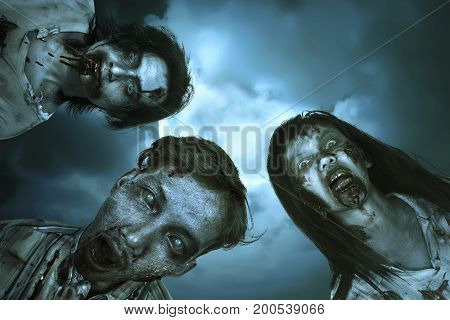Portrait group of asian bloody zombies with wounded face over full moon background