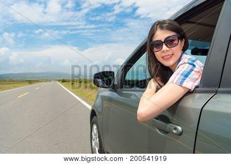 Leisurely Female Tourist Wearing Sunglasses
