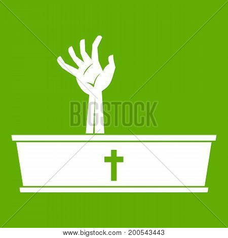 Zombie hand coming out of his coffin icon white isolated on green background. Vector illustration