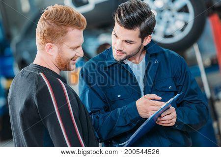 Automechanic Showing Client Clipboard
