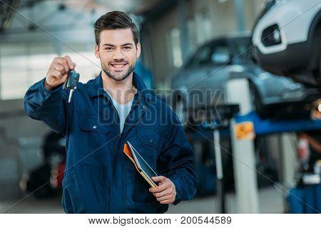 Automechanic Holding Car Keys