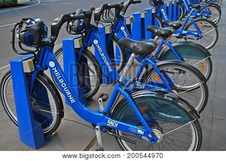 Melbourne Australia - March 20 2016: Bike share station is located at Flinders Street opposite Federation Square. People can rent bicycles and explore the city.