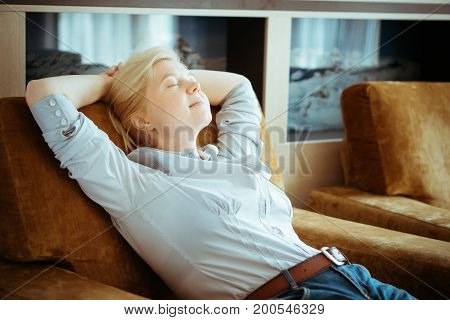 Woman In Casual Clothes Resting At Home.