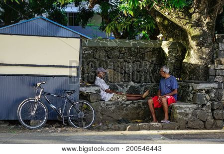 Old Men Sitting On Road In Le Morne, Mauritius