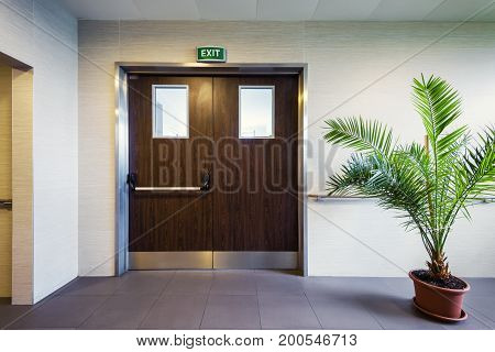 Modern interior with emergency exit in office or clinic