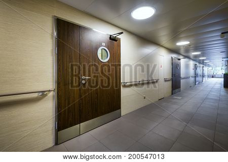 Moscow - July 25, 2017: Corridor in a modern hospital with wooden doors