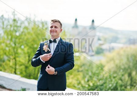 Portrait Of A Stunning Young Groom Posing On His Wedding Day On His Own.