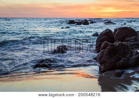 Wave Of The Sea On The Sand Beach. Seashore On Sunset