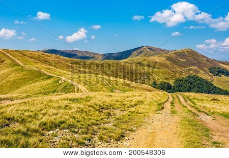 Road Through Hilly Ridge With Peaks