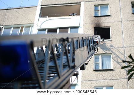 The Ladder Of A Fire Engine To A Burning House