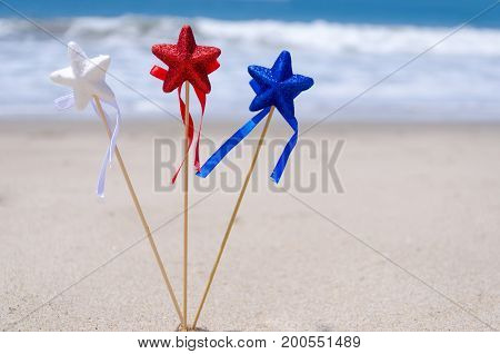 Patriotic USA background with decorations on the sandy beach - holiday concept
