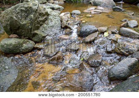 close up brook in Chantathen waterfall , Chonburi , Thailand