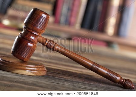 Counselor concept. Gavel, golden scale of justice.