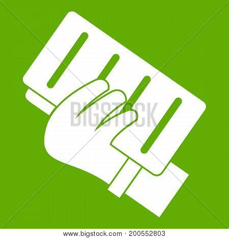 Brick in a hand icon white isolated on green background. Vector illustration