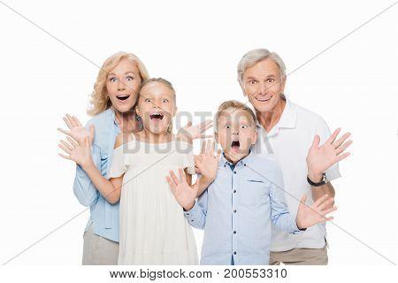 Surprised Grandparents With Grandchildren