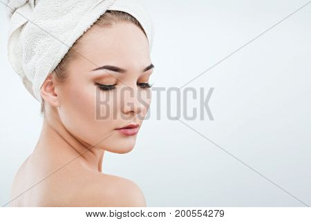 Pretty Girl With Naked Shoulders And White Towel On Hair