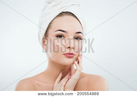 Attractive Girl With Naked Shoulders And White Towel On Hair