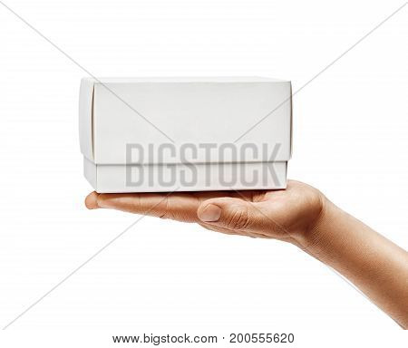 Man's hand holding white box isolated on white background. Close up. High resolution product
