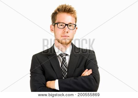 Young, handsome business man wearing black suit. Isolated on the white background.