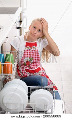 Bored Woman With Dishwasher
