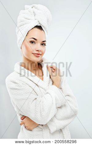 Attractive Girl With Dark Hair Wearing Bath Robe And Towel