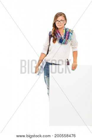 Beautiful student woman pointing on blank board. Student.