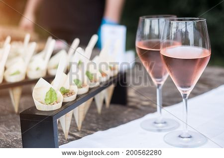 Wine Glasses And Appetizers On A White Tablecloth Party