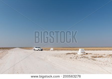 ETOSHA NATIONAL PARK NAMIBIA - JUNE 26 2017: Unidentified tourists on the gravel road between Okaukeujo and Olifantsrus in the Etosha National Park
