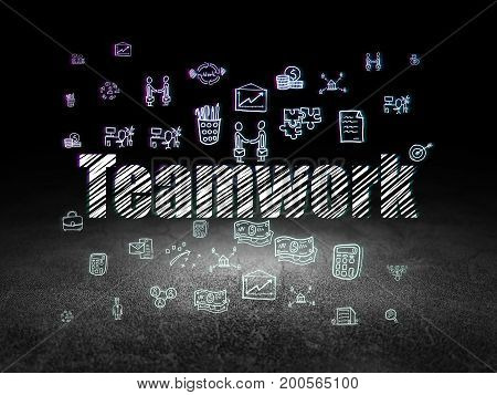 Business concept: Glowing text Teamwork,  Hand Drawn Business Icons in grunge dark room with Dirty Floor, black background