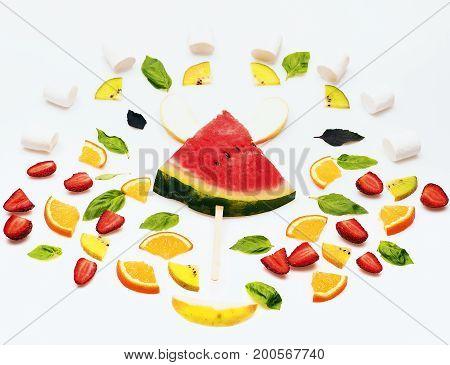 Watermelon, Strawberry, Leaves, Kiwi And Orange Isolated On White