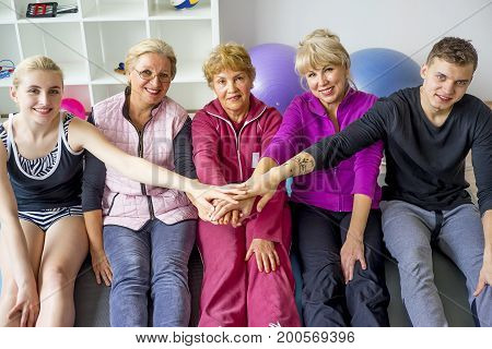 Group of elderly people doing exercises in a gym