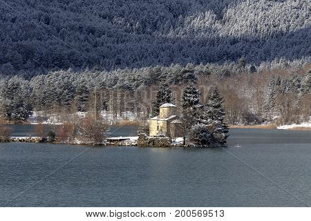 The ancient church of St. Fanur on the lake  Pineiou in winter