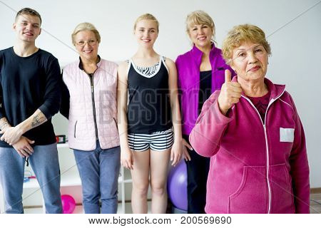 Group of seniors doing exercises in a gym