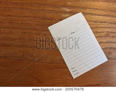 Blank paper note on the wood table