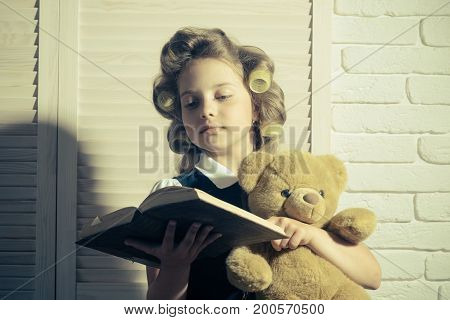 Small Girl With Curler In Hair.