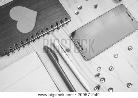 Mobile phone notebook pens pushpin black and white frame