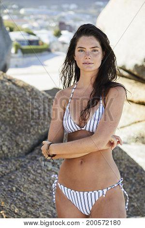 Beautiful beach babe in striped bikini portrait