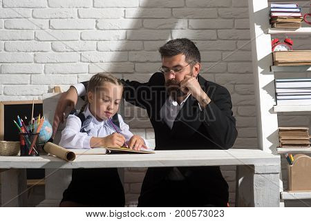 Girl And Her Father Learn How To Write