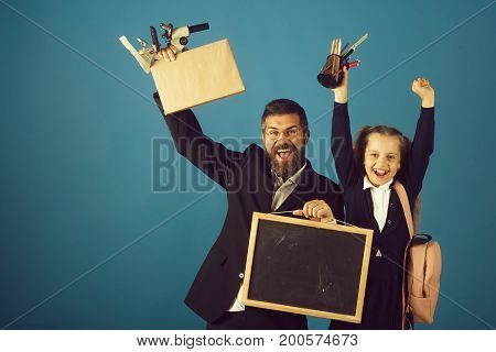 Kid And Tutor Hold School Supplies And Blackboard