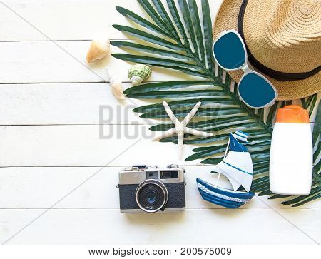 Summer Fashion woman big hat and accessories camera and sunglasses go to travel in the beach. Tropical sea.Unusual top view background. Summer Concept.