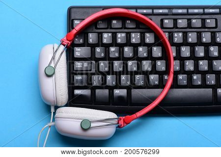 Music And Digital Equipment Concept. Headphones And Black Keyboard