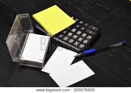 Business Card Holder, Blank Cards And Calculator On Black Background