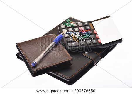 Leather Covered Notebook, Wallet, Pen And Paper Clips, Close Up