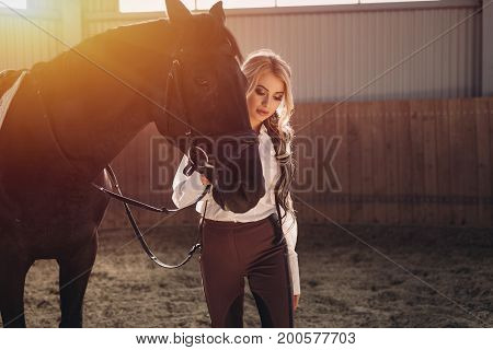 Beautiful Elegant Young Blonde Girl Standing Near Her Horse Dressing Uniform Competition