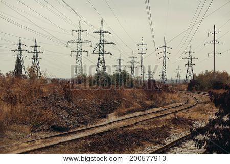 Industrial foggy landscape - old abandoned industrial zone in autumn forest Horizontal image