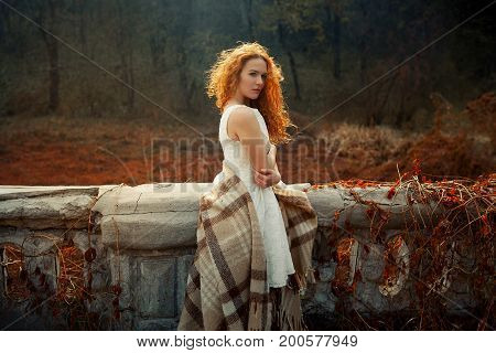 Red Hair Girl At Sunrise Wrapped In A Red Blanket
