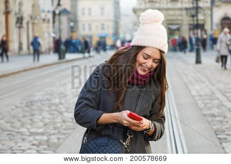 Laughing Young Woman Holding Red Smart Phone