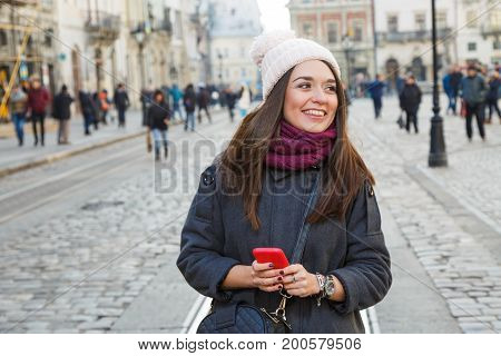 Charming Young Woman Holding Red Smart Phone
