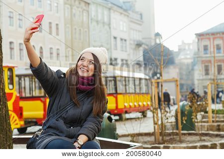 Happy Young Woman Taking Selfie On Smart Phone