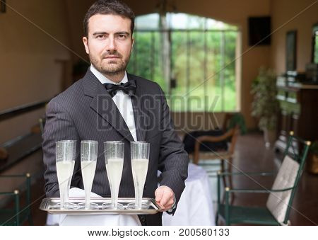 Professional Waiter Serving Champagne Wine Glasses